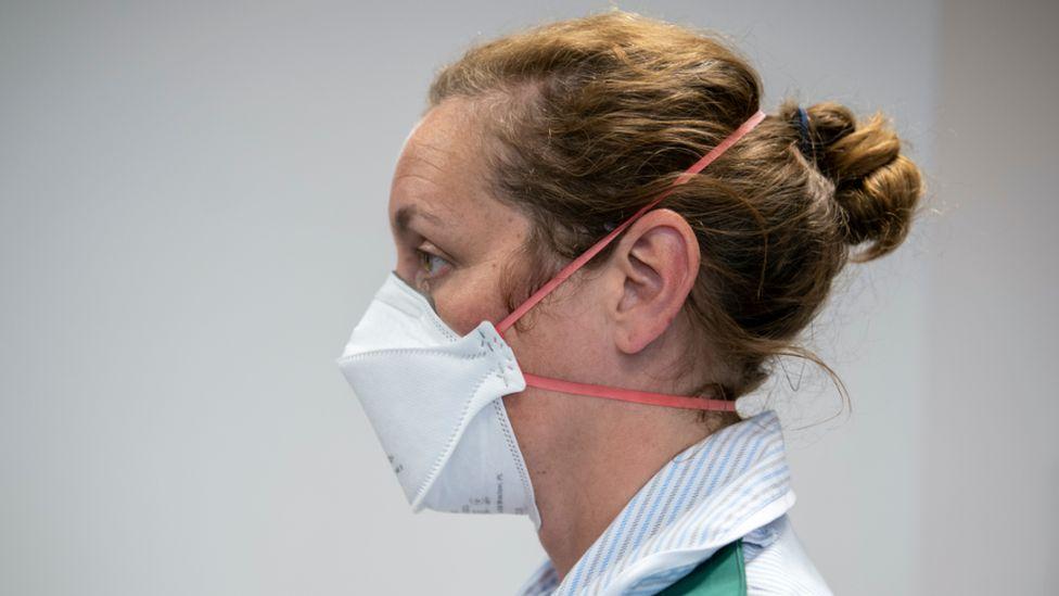 Woman wearing an FFP3 mask
