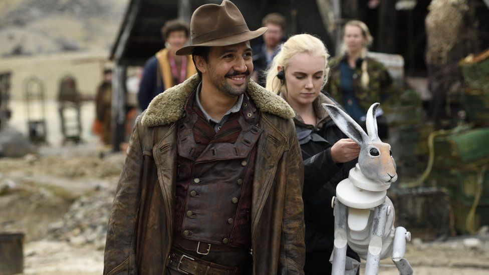 """Lin-Manuel Miranda on set with a model of his hare """"daemon"""""""