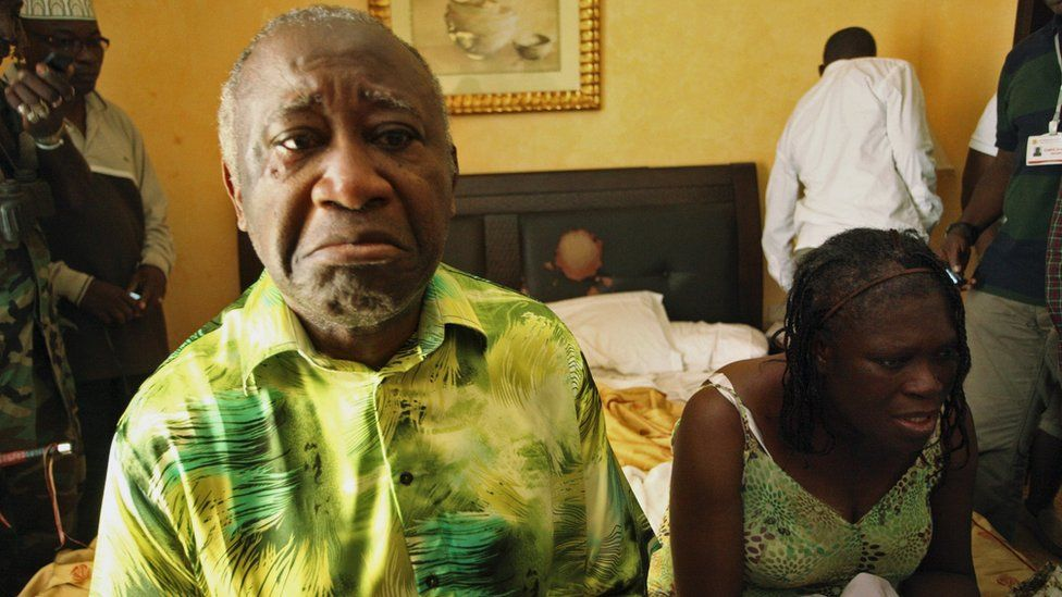 Laurent and Simone Gbagbo sit in a hotel room after their arrest