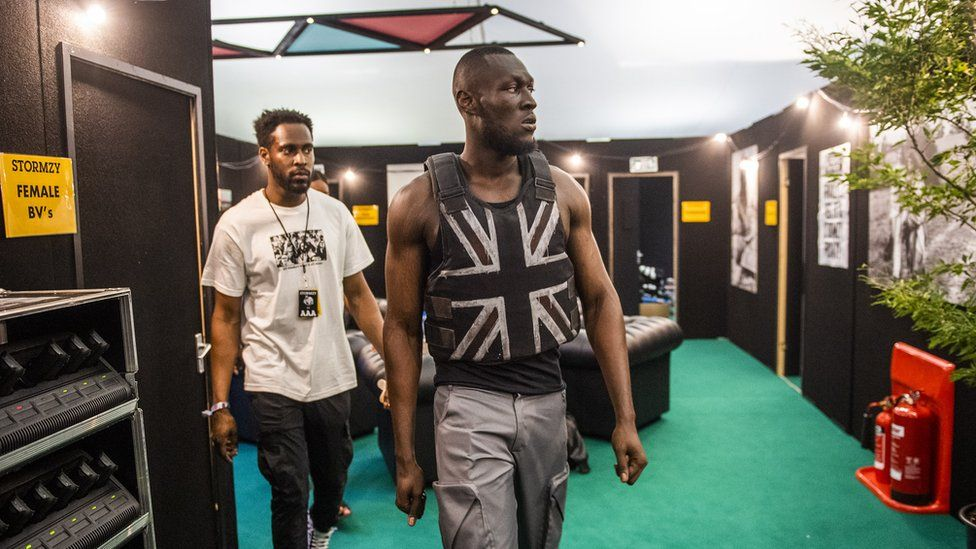 Stormzy walking on stage
