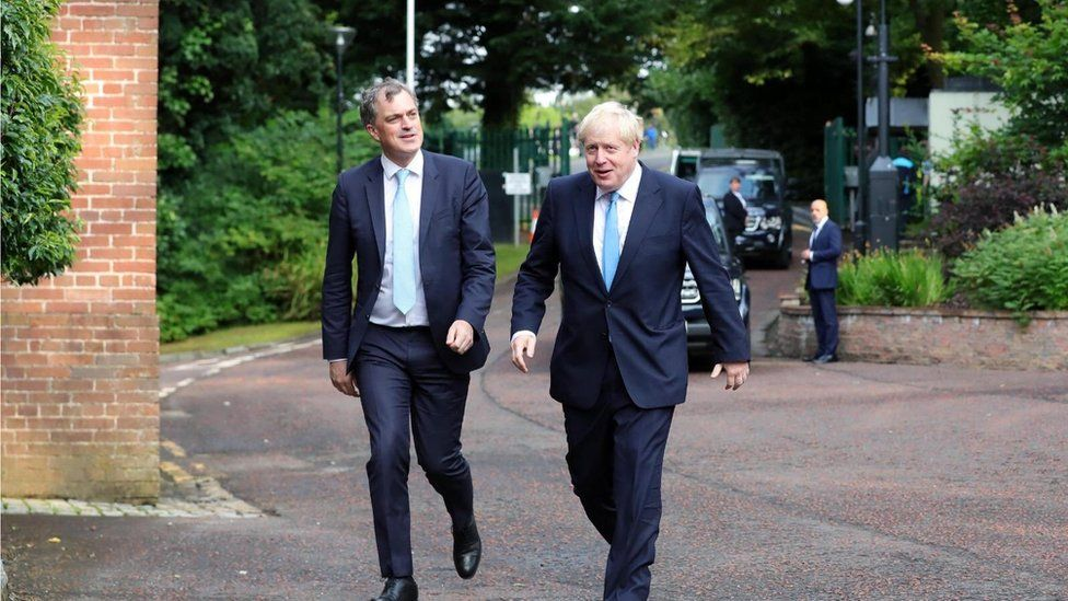 NI Secretary Julian Smith with Prime Minister Boris Johnson as he arrived at Stormont