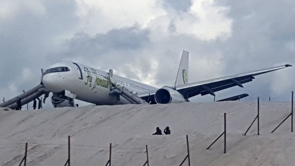 A Toronto-bound Fly Jamaica airplane is seen after crash-landing at the Cheddi Jagan International Airport in Georgetown, Guyana on November 9, 2018