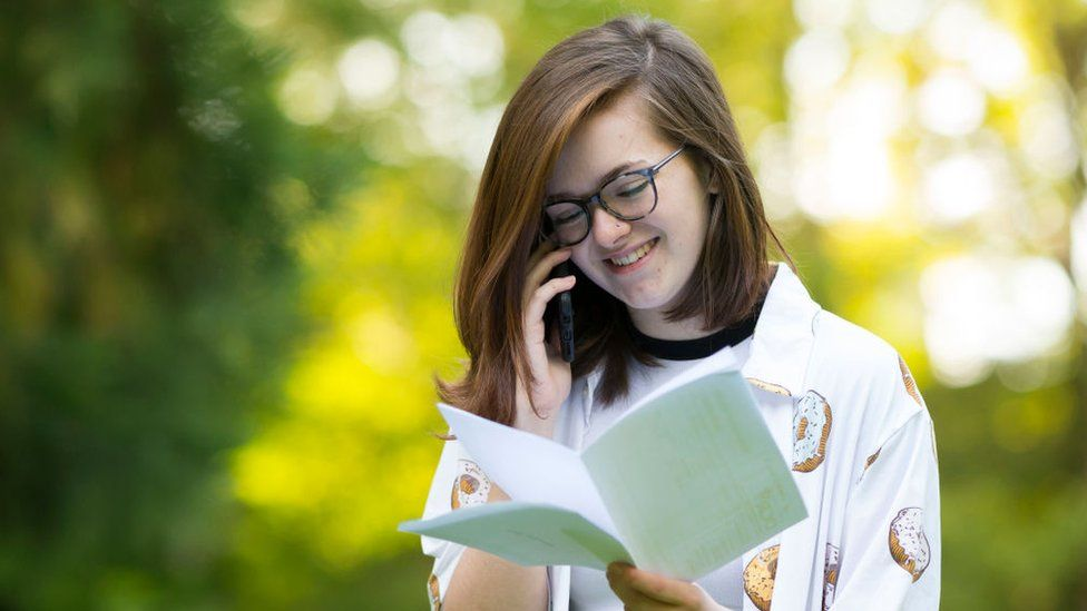 Kathryn Bond speaks on the phone after receiving her A -level results on August 15, 2019 in Swansea