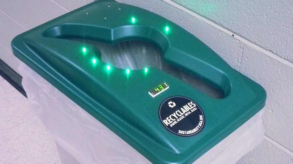 Lid of smart bin with lights lit up in the shape of a smiley face