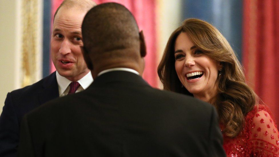 The Duke and Duchess of Cambridge speak to a guest at their evening reception at Buckingham Palace