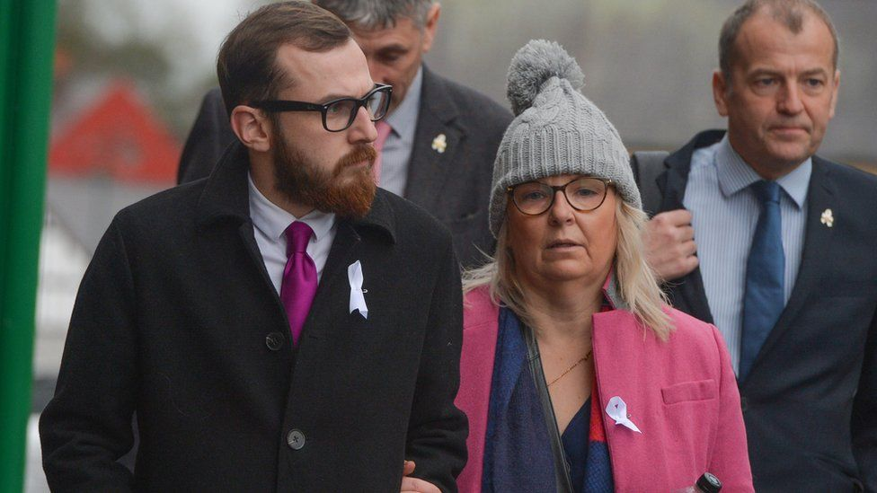 Carl Sargeant's son Jack and wife Bernadette arrive at his inquest at Ruthin County Hall