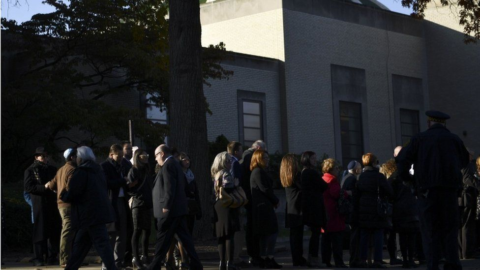 A long line has formed outside the Rodef Shalom Congregation ahead of the first funeral service for the victims