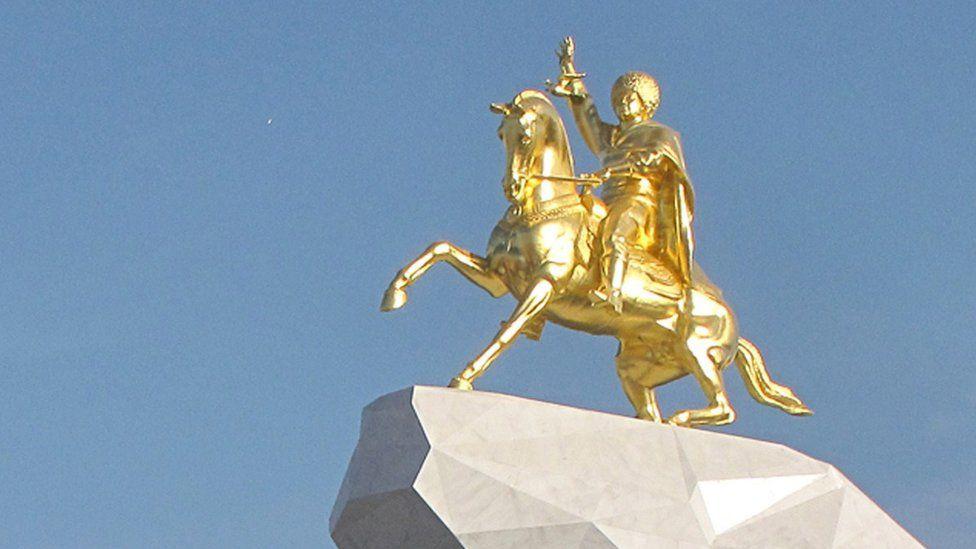 A golden monument of Turkmenistan's President Berdymukhamedov on horseback in Ashgabat