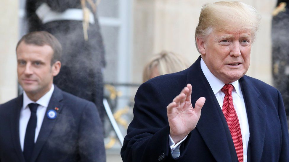 US President Donald Trump (R) waves as he leaves the Elysee Palace in Paris on November 10, 2018