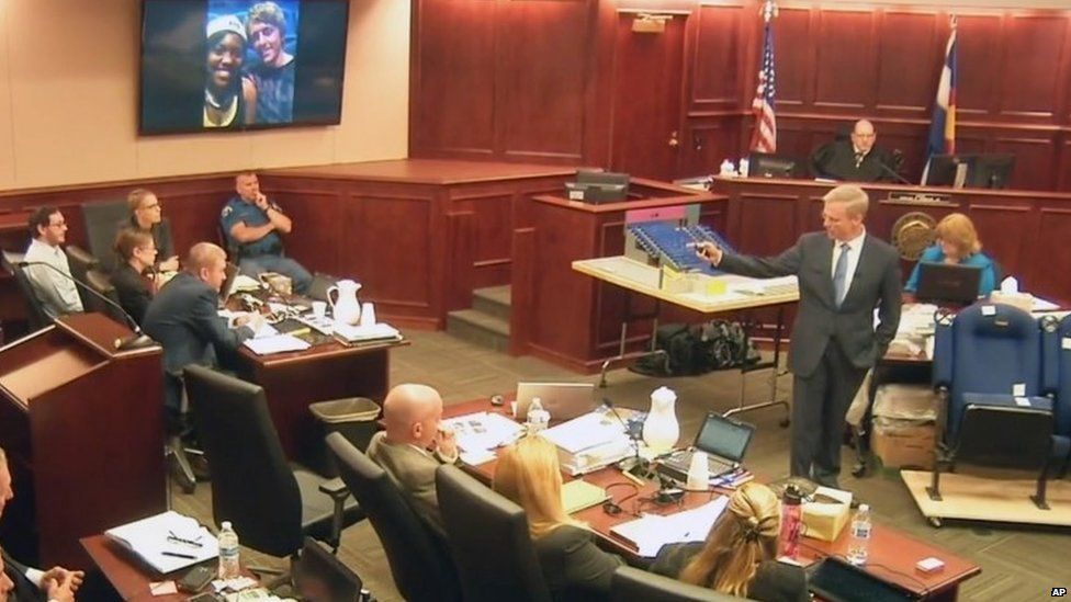 Image taken from video showing James Holmes, left, listening to lead prosecutor George Brauchler
