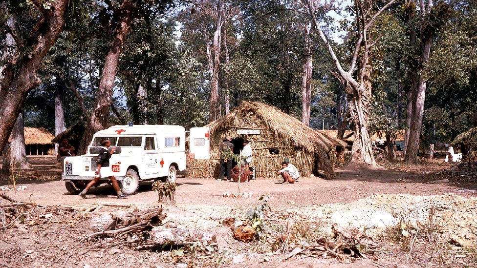 One of the project ambulances at a health post at a temporary camp on the East-West Highway at Butwal in about 1969.