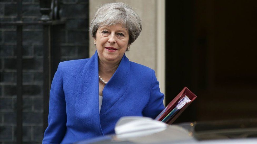 Prime Minister Theresa May leaves 10 Downing Street in central London