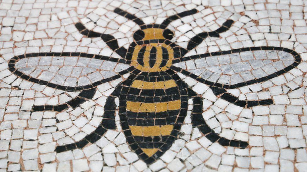 A Manchester Worker Bee incorporated into the floor of the Town Hall in Manchester.