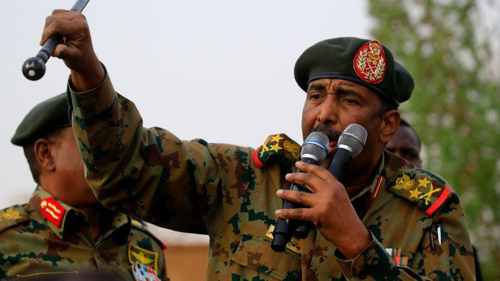 Gen Burhan addressing a crowd