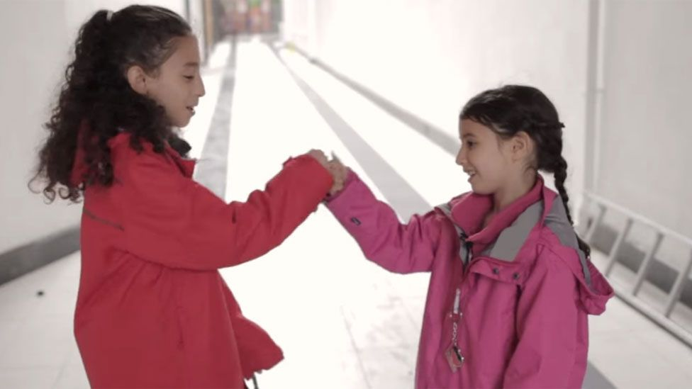 Still showing two girls from Hoda El Soudani's film 'Why can't I be a Sushi?'