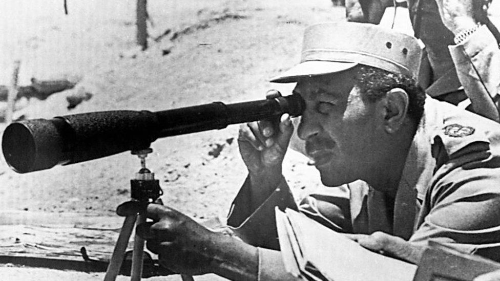 President Anwar Sadat of Egypt visits army positions at the Suez Canal during the October 1973 Arab-Israeli war