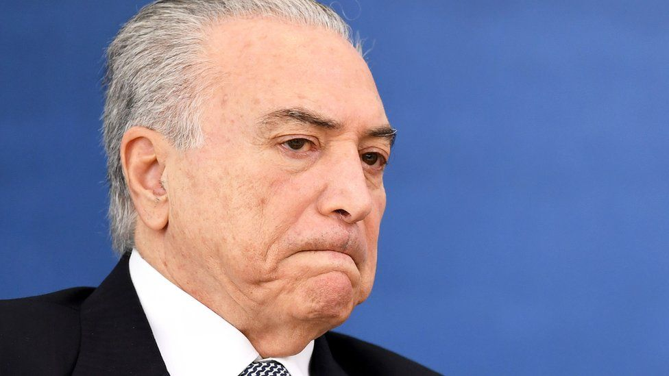 """Brazil""""s President Michel Temer gestures during the launch ceremony of a new credit card to finance the home construction for low-income workers at Planalto Palace in Brasilia, on November 24, 2016."""
