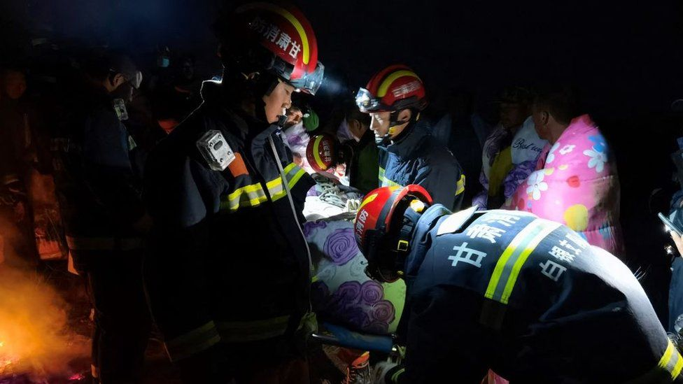 Rescuers assisting people who were competing in a cross-country mountain race when extreme weather hit the area