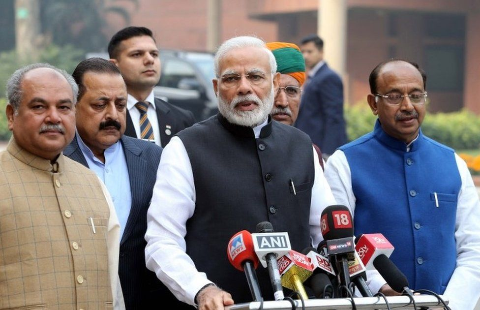 Indian Prime Minister Narendra Modi (C), addresses the media as he arrives for the first day of the Winter Session of the Parliament, in New Delhi, India, 11