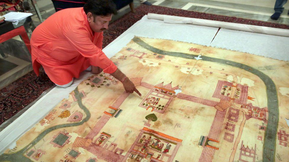 Ramu Ramdev, OSD at the City Palace, points out Lord Ramas birth place in an old dilapidated map of Ayodhya depicting the birthplace of Lord Rama, being taken out from archives of erstwhile royal family of Jaipur, at City Palace, on August 11, 2019 in Jaipur, India.