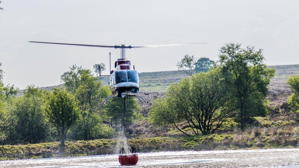 Helicopter picking up water