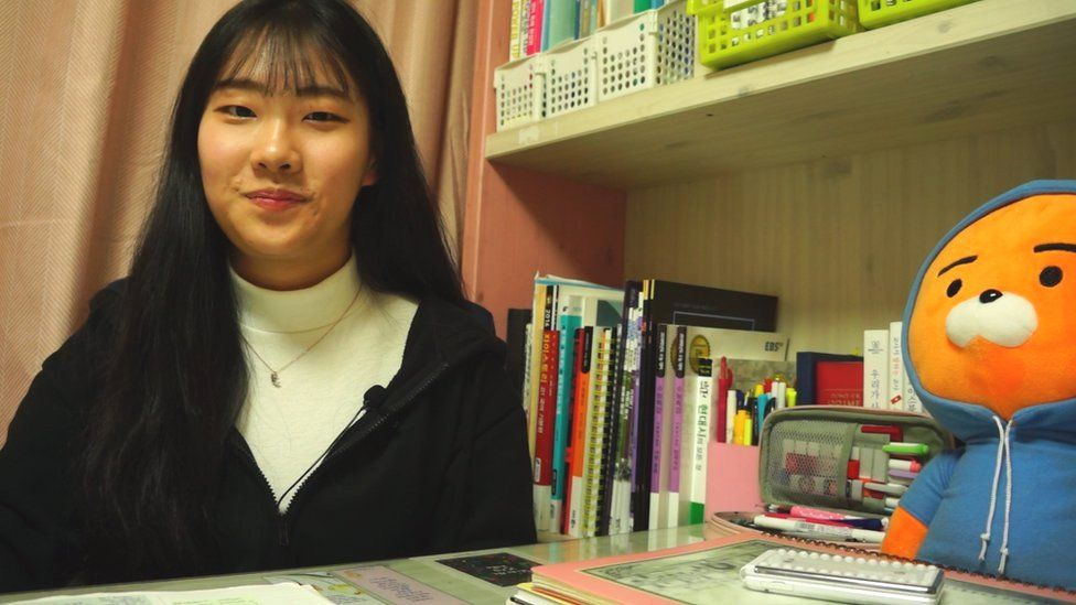 Ko Eun-suh in her bedroom full of textbooks and revision notes