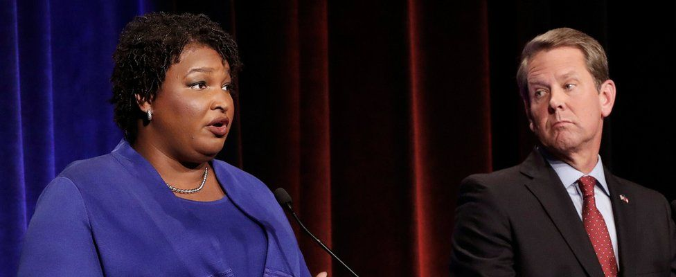 Democratic gubernatorial candidate for Georgia Stacey Abrams speaks as Republican candidate Brian Kemp looks on