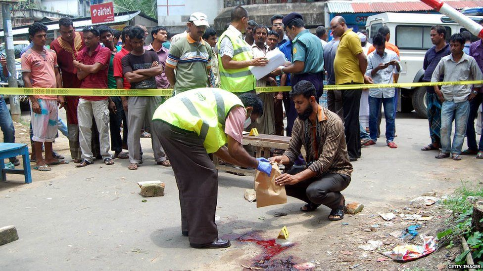 A police officer investigates at the spot where Bangladeshi blogger Ananta Bijoy Das was killed, in Nurani area of Sylhet, Bangladesh, 12 May 2015.