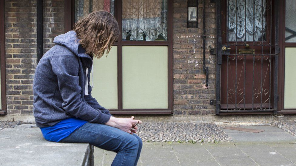 A teenager on a housing estate