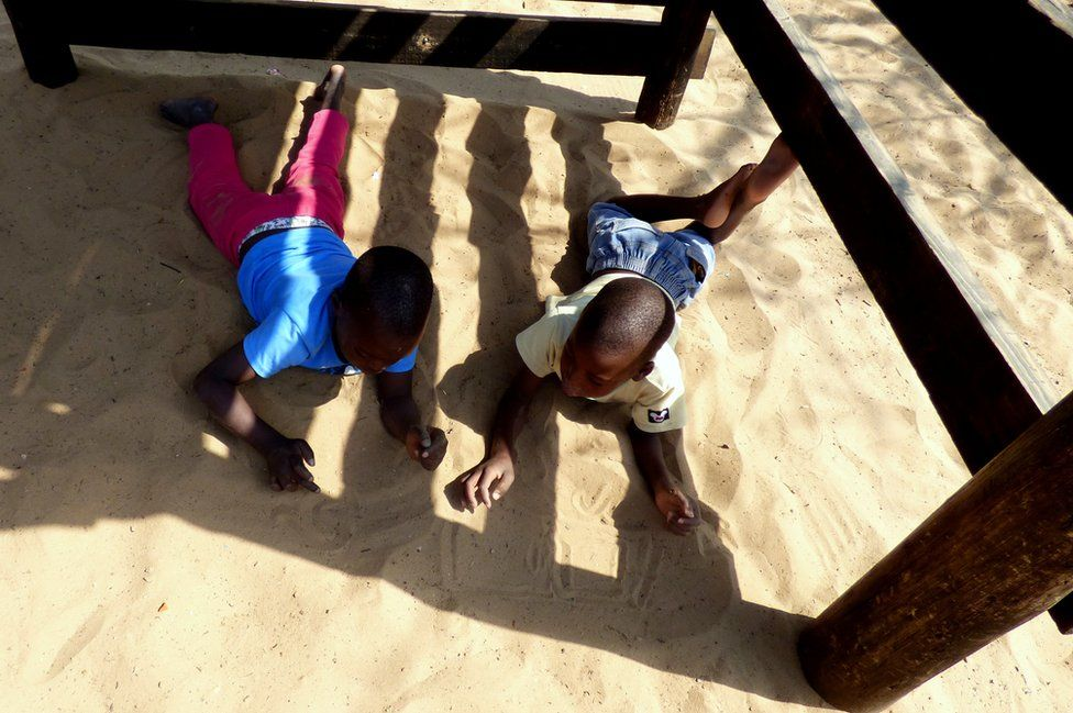Two children play in the sand