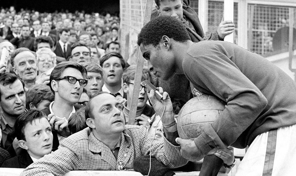 Portugal's Eusebio giving an impromptu pitchside interview at the game against North Korea at Goodison Park