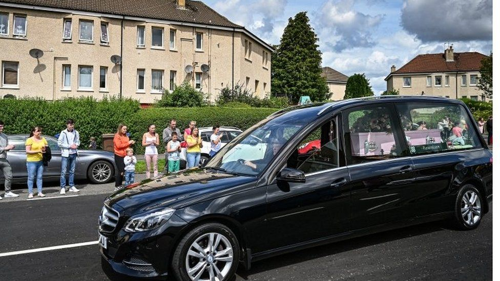 Fiona's pink coffin led the procession as local people paid their respects