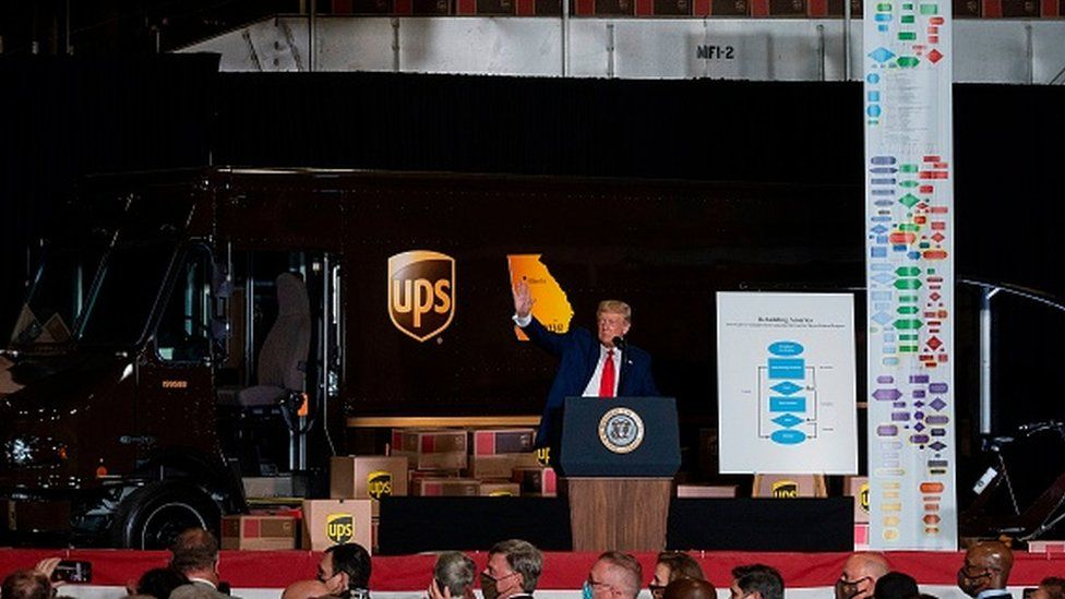 President Donald Trump arrives to speak at an event at the United Parcel Service (UPS) Airport Facility in Atlanta, Georgia