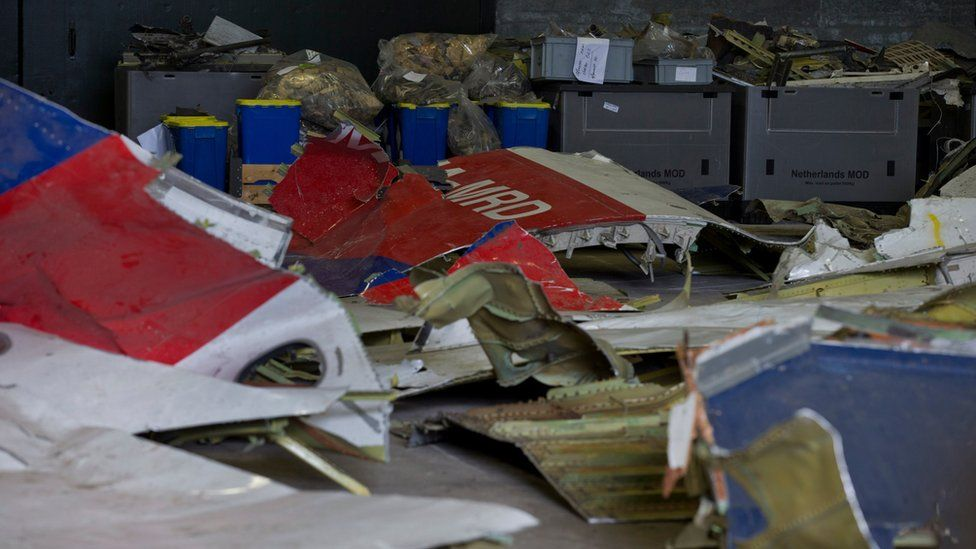 Parts of the wreckage of the Malaysia Airlines Flight 17 are displayed in a hangar at Gilze-Rijen airbase, Netherlands (March 2015)
