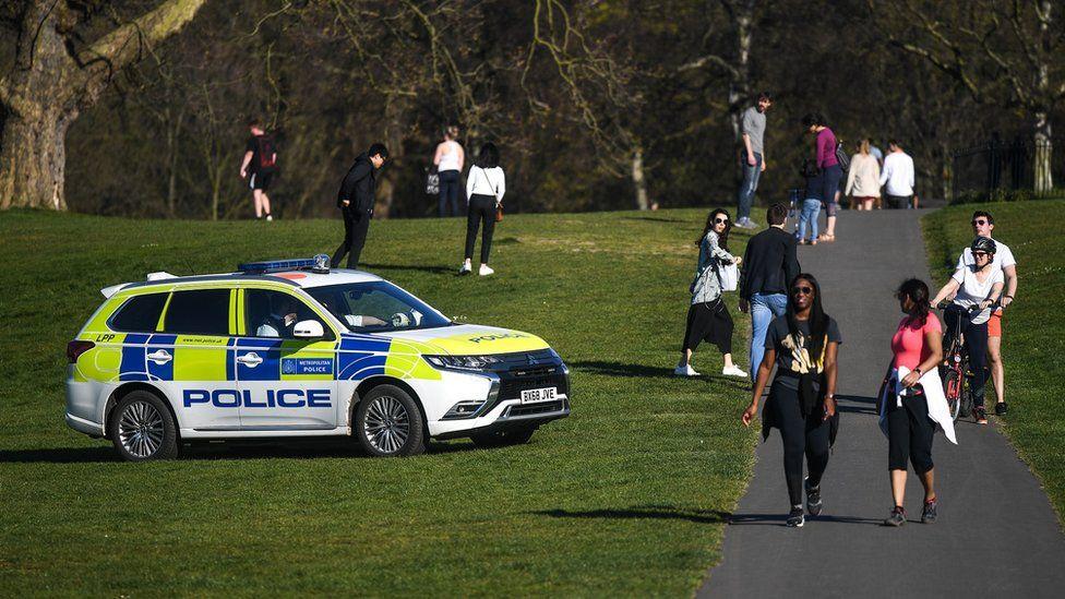 A police car patrolling Greenwich Park in London in April