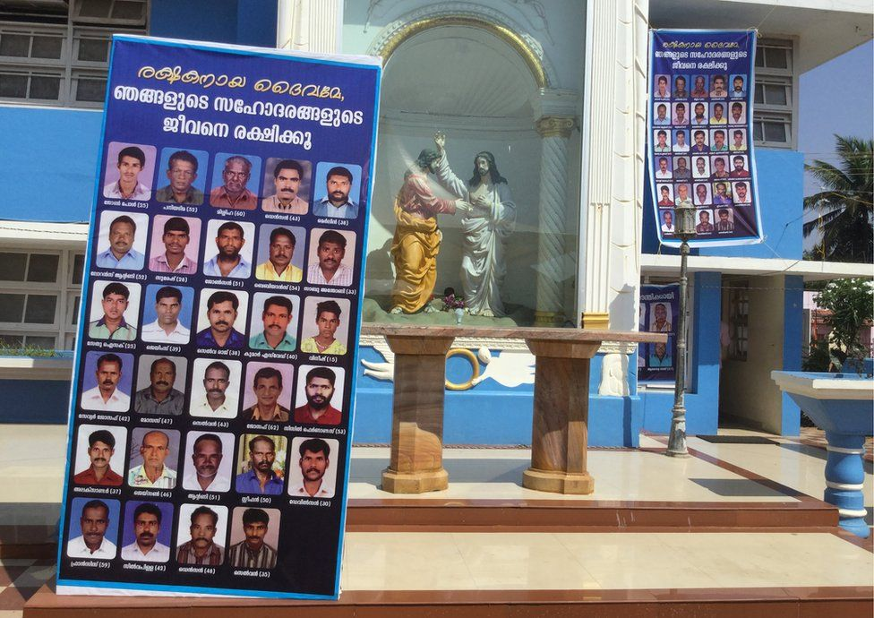 Photographs of the missing fishermen displayed at a local church