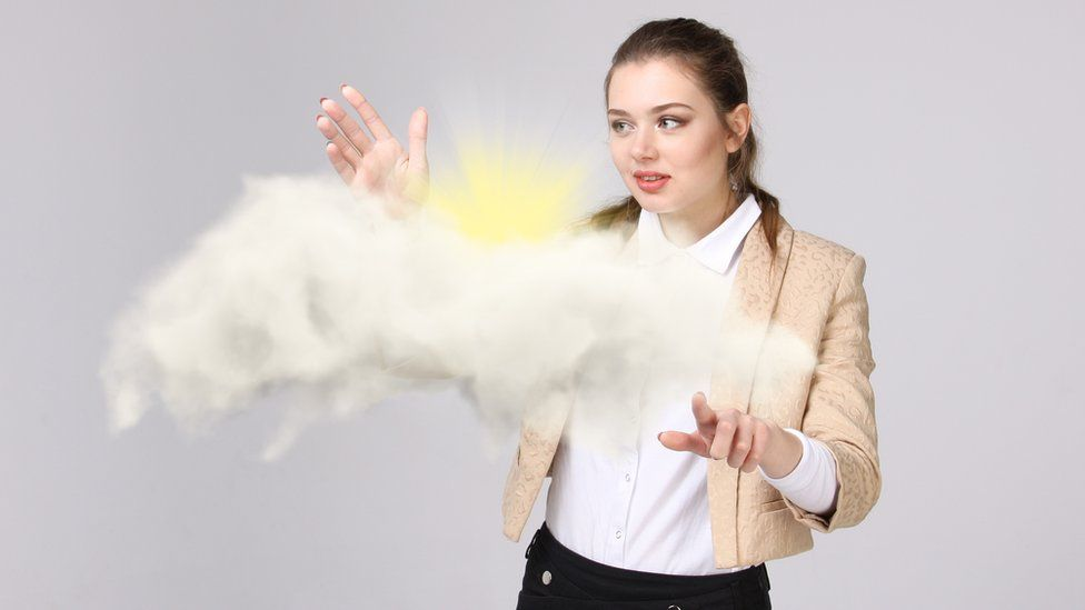 Woman with cloud and sun