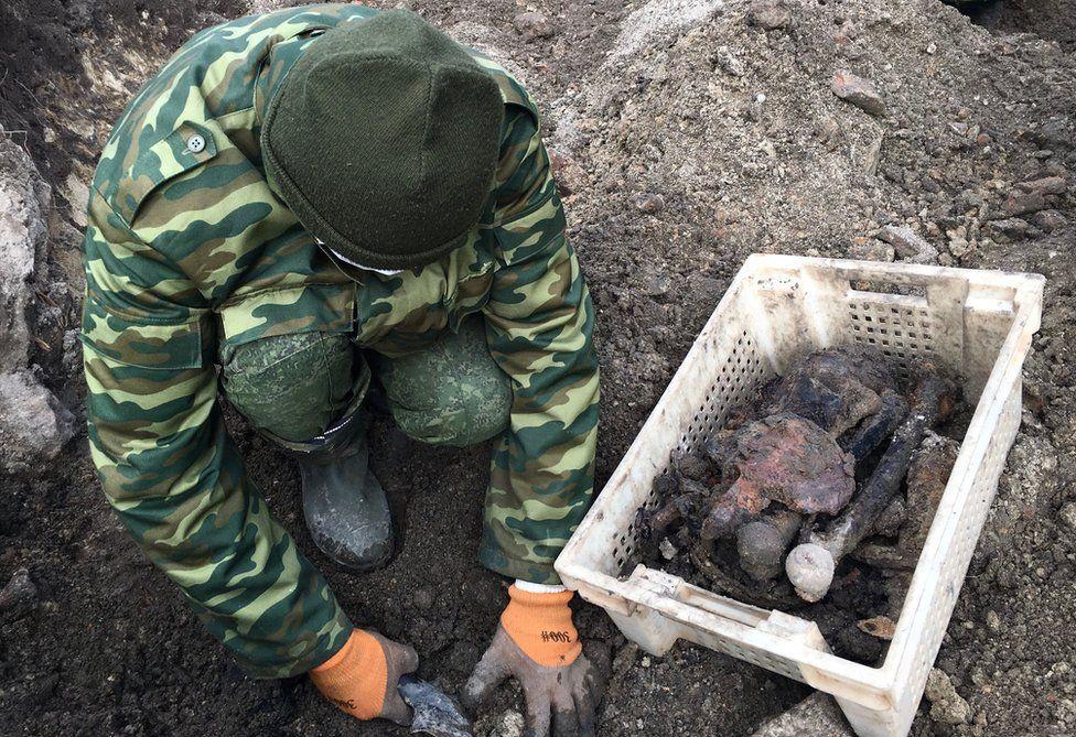 Digger at Brest grave site