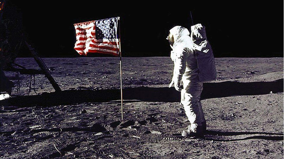 "This NASA file photo taken on July 20, 1969 shows astronaut Edwin E. ""Buzz"" Aldrin, Jr. saluting the US flag on the surface of the Moon"