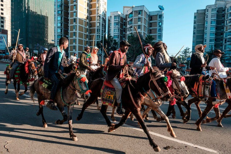 Horsemen trot through Ethiopia's capital Addis Ababa in early December