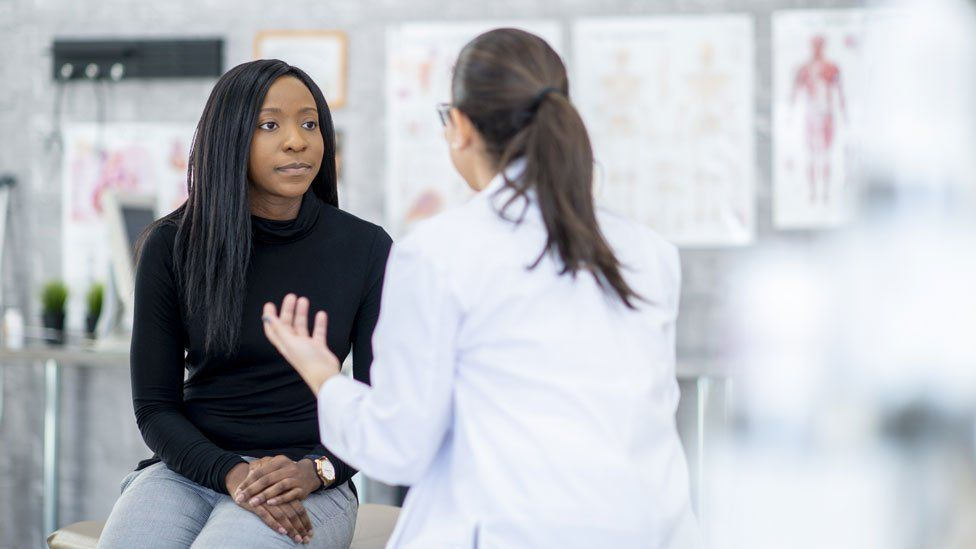 A stock image of a doctor and patient