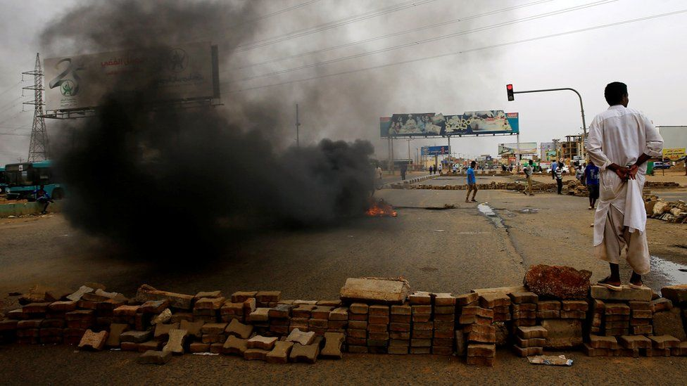 """A Sudanese protester stands near a barricade on a street, demanding that the country""""s Transitional Military Council handover power to civilians, in Khartoum, Sudan June 4, 2019."""