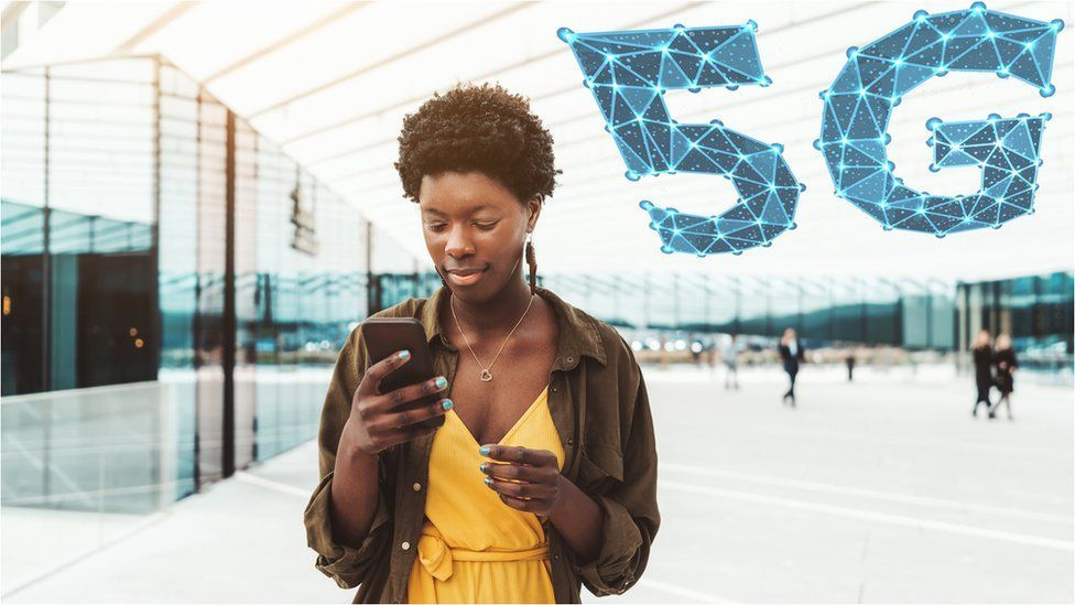 A woman using 5G to access the internet on her smartphone