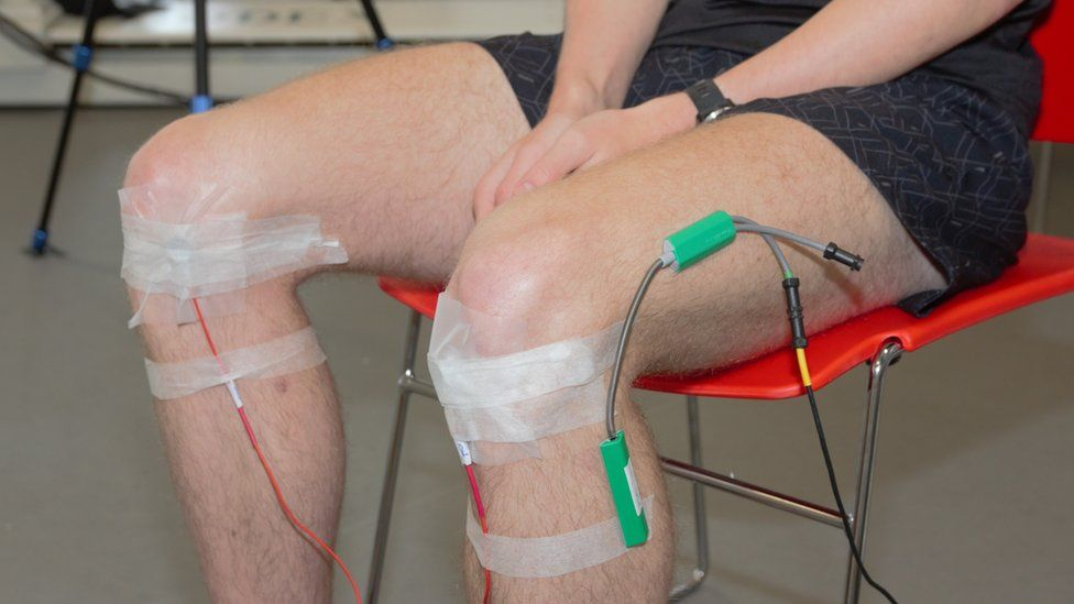 Microphones are attached to the knees to pick up high-frequency noises