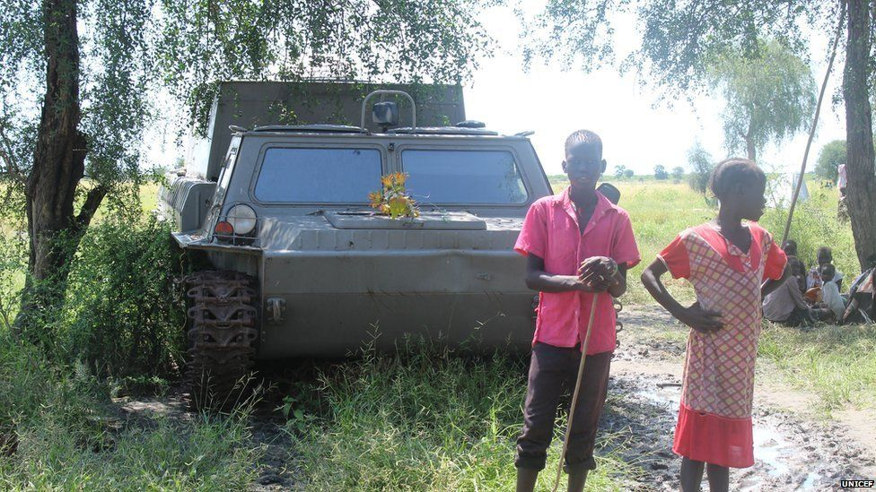 Children playing near an abandoned military vehicle