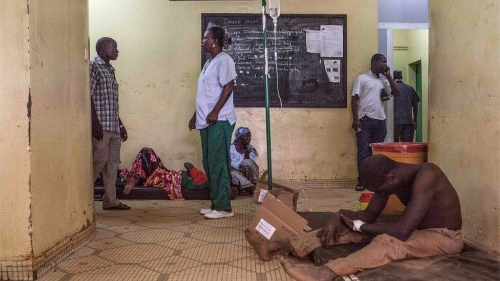 A protestor, right, injured during clashes receives treatment in a hospital in Ouagadougou, Burkina Faso, Thursday, Sept. 17, 2015