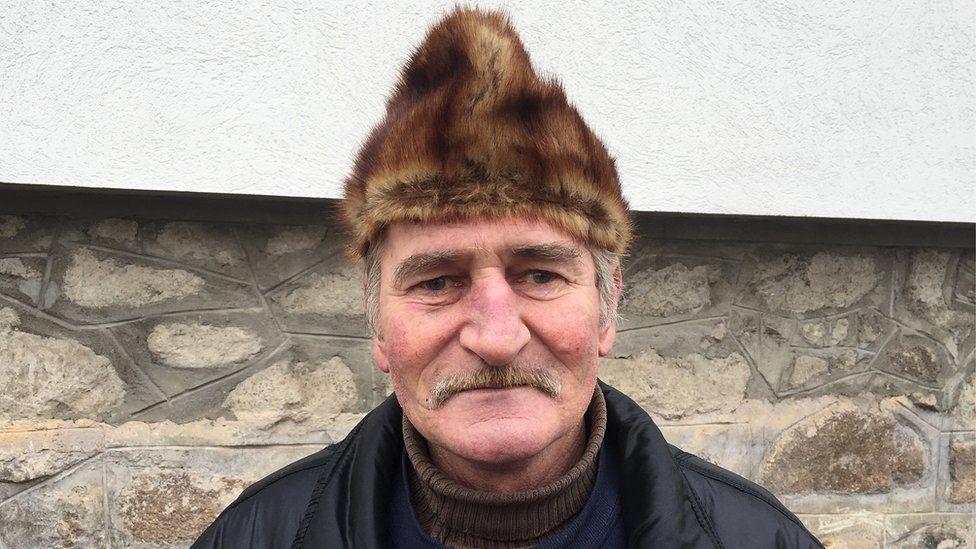 Ditrau resident Adalbert Horváth, 54, wearing a furry hat