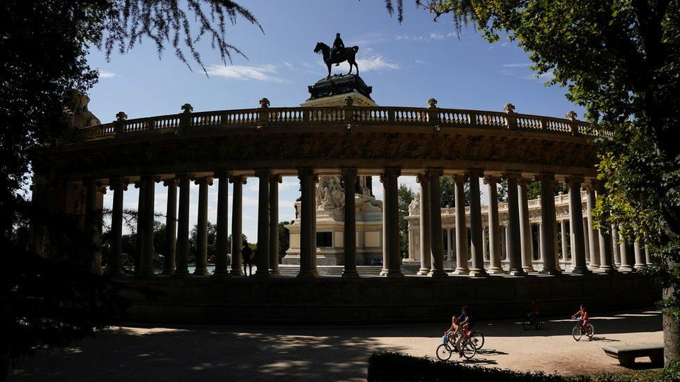People ride bikes at Retiro Park on the day that Unesco added Madrid's historic Paseo del Prado boulevard and Retiro Park to its list of world heritage sites, in Madrid, Spain, 25 July 2021