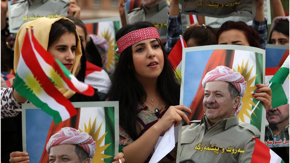 Iraqi Kurdish students hold posters of Iraqi Kurdish leader Massud Barzani during a protest in his support in Arbil, the capital of Iraqi Kurdistan, on October 30, 2017.