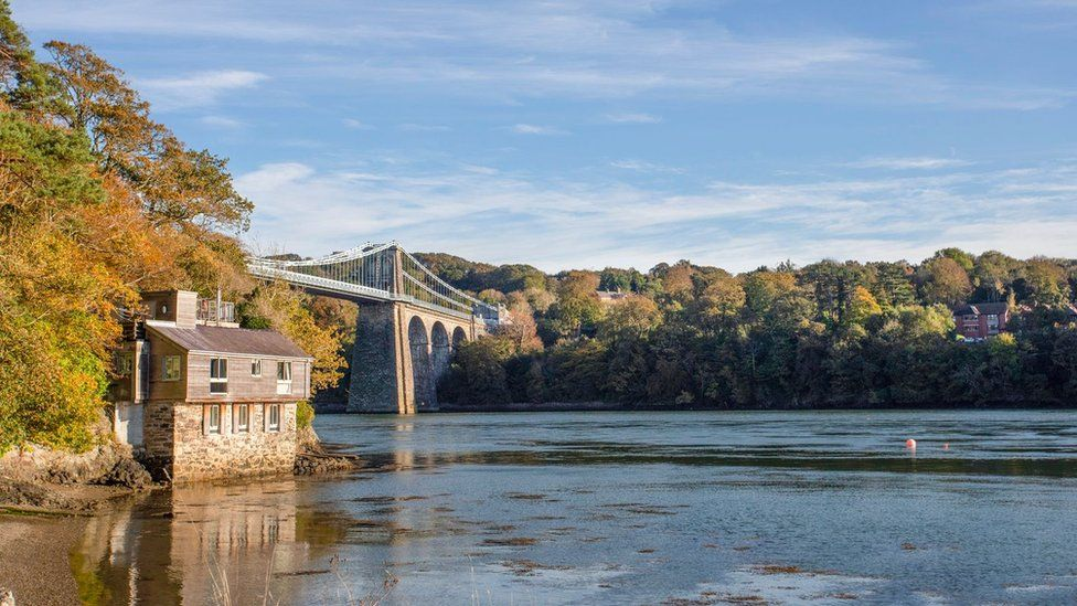 A view of the Menai Strait and Menai Bridge beside Belgian Prom on Anglesey